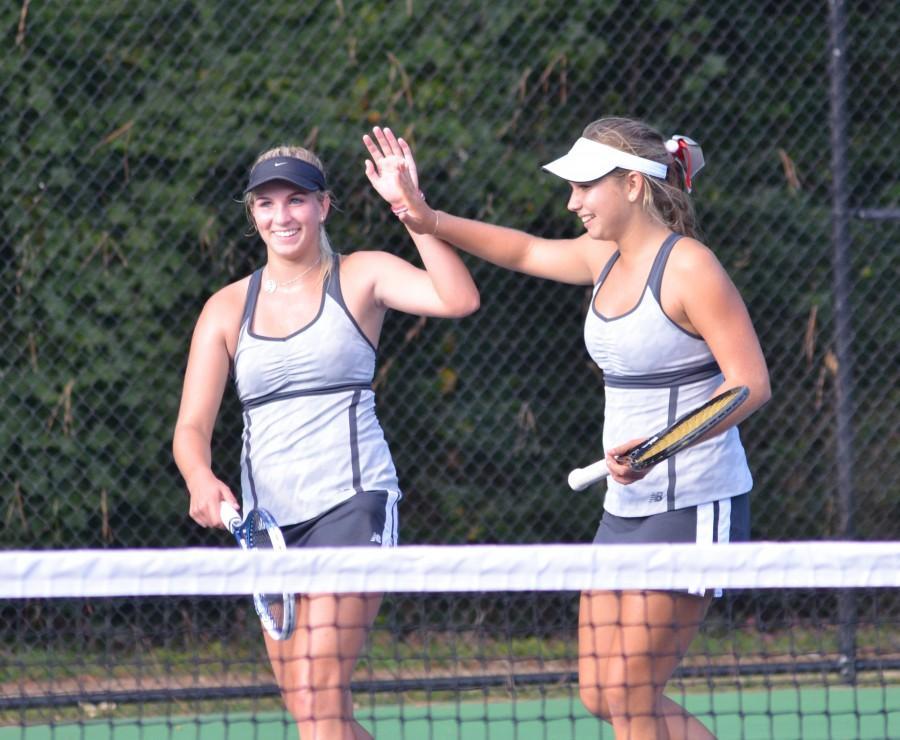 Girls' Varsity Tennis wins again.