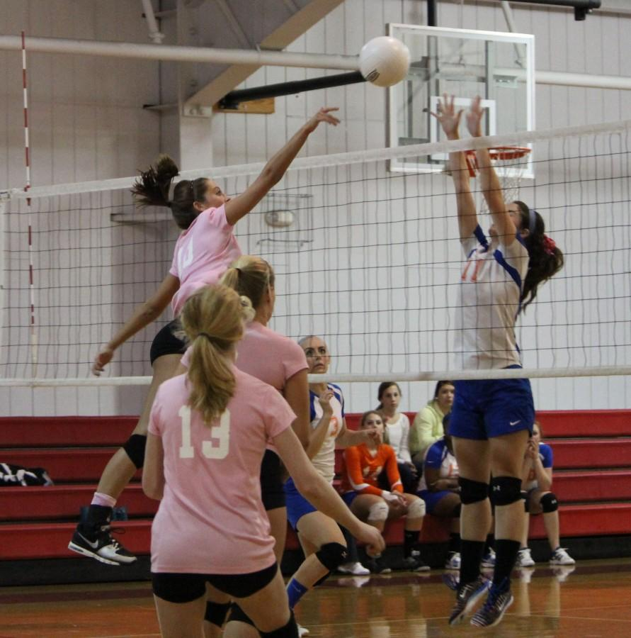 Girl's Varsity Volleyball encourages their competition to