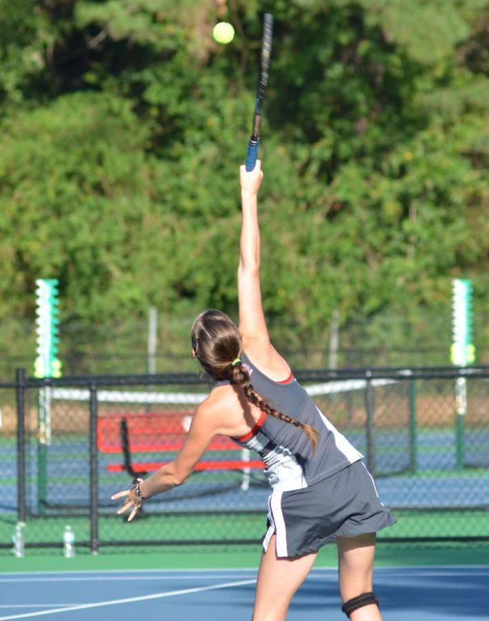 Pence serves it up in the early season. Indicative of the good things to come for Girls' Tennis!