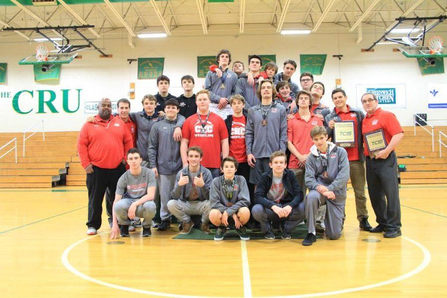 Photo+Credit%3A++Julie+Reid+-++Varsity+Wrestlers+celebrate+their+TCIS+Tournament+win.