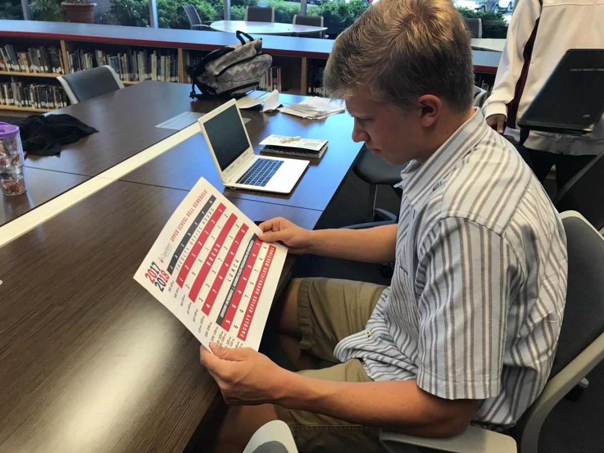 Travis Horvath, '18, looks at the schedule to try  and figure out what class comes next. Photo Credit: Rileigh Ramirez