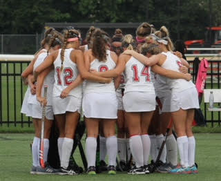 The team having a moment together before they head on to the field to face competition.  Photo Credit: Mr. Daniel Burke