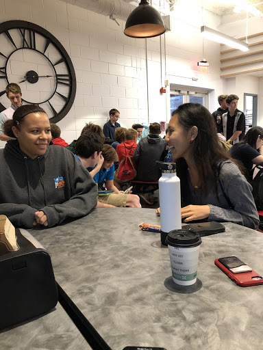 Juniors Kiara Baxter and Abbey Trinidad wait to be released into the gym for the PSAT. The new freshmen taking the test for the first time gathered behind them.