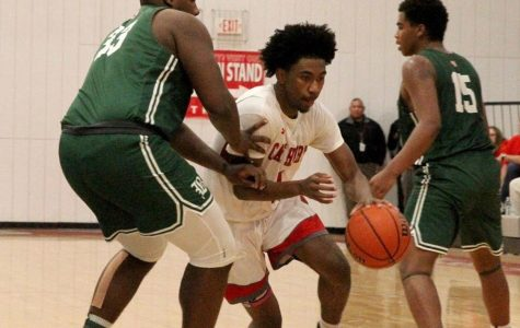 Christian Moore ('21) dribbles between two Benedictine defenders, Cape Henry defeated Benedictine with a final score of 76-64. Photo credit: Dan Burke