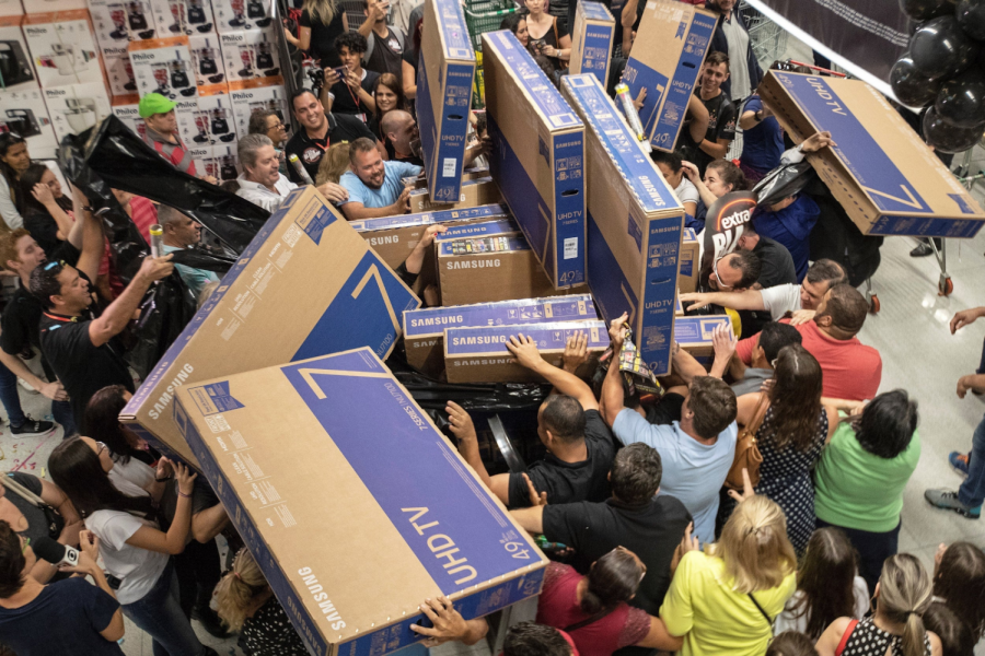 In this picture, people buy televisions in a market in an overcrowded market in Sao Paulo. Many people want to get cheaper products on Black Friday and will risk crowds and safety to get them. Photo Credit: www.independent.co.uk