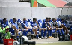 KSC players sit on the bench observing social distancing and wearing face masks to protect against coronavirus, sit on the bench during the 2nd Bundesliga soccer match between Karlsruher SC and SV Darmstadt 98, in Karlsruhe, Germany, Saturday, May 16, 2020. Professional soccer has resumed after a two-month break in Germany with four games in the second division. (Matthias Hangst/Pool Photo via AP)